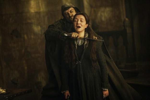 Catelyn gets her throat sliced at the Red Wedding