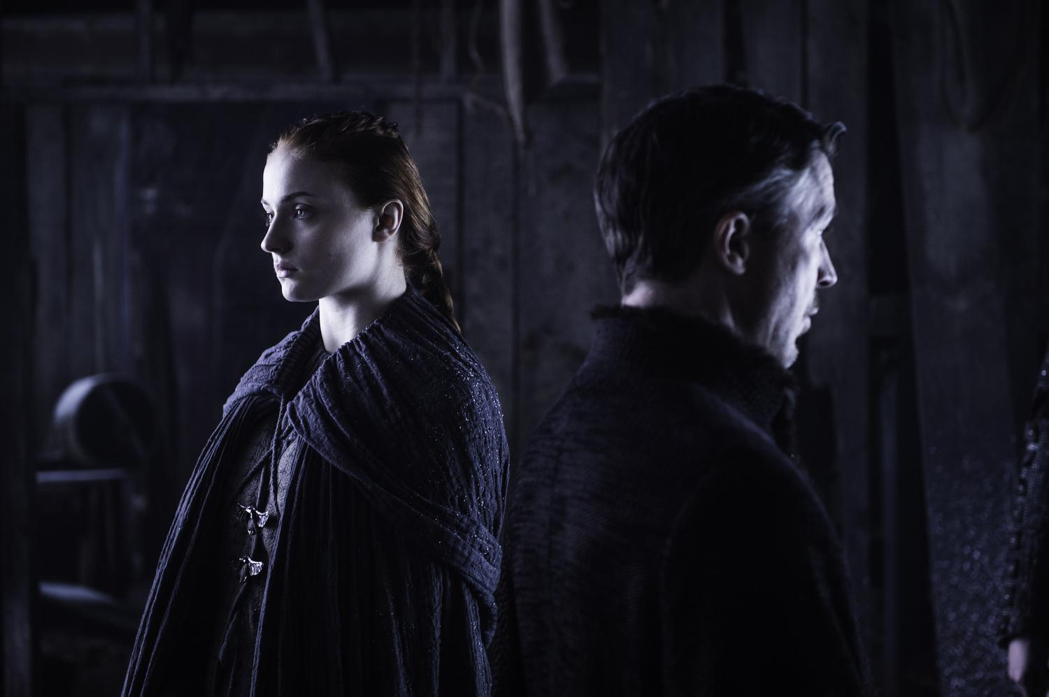 Sophie Turner as Sansa Stark and Aidan Gillen as Petyr
