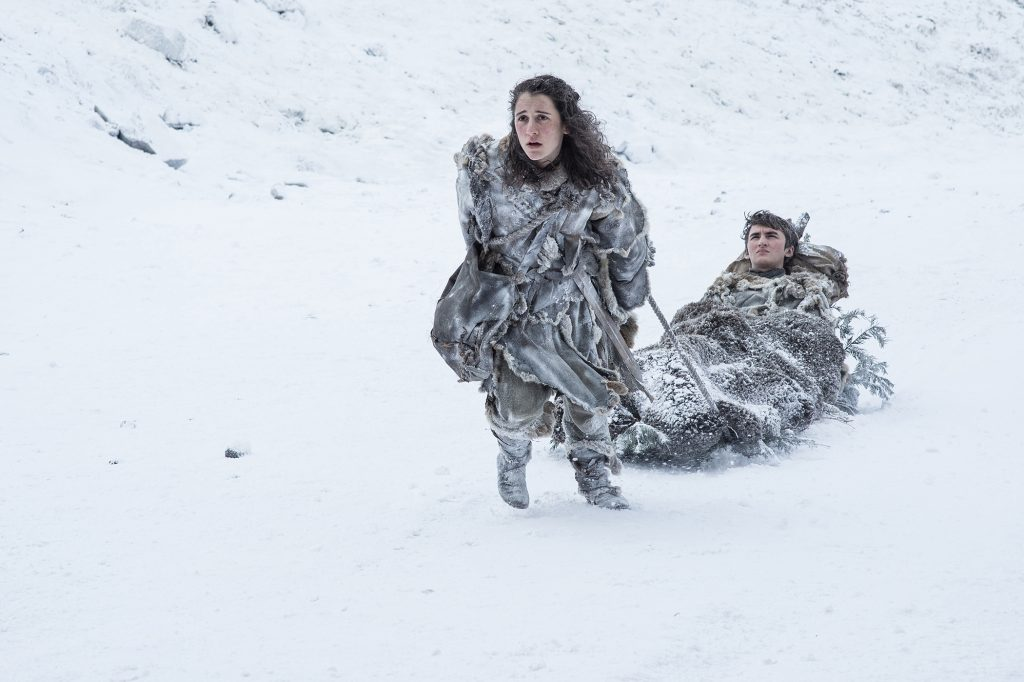 Meera Reed (Ellie Kendrick) carrying Bran Stark (Isaac Hempstead Wright) near the Wall / Photo: Helen Sloan/HBO