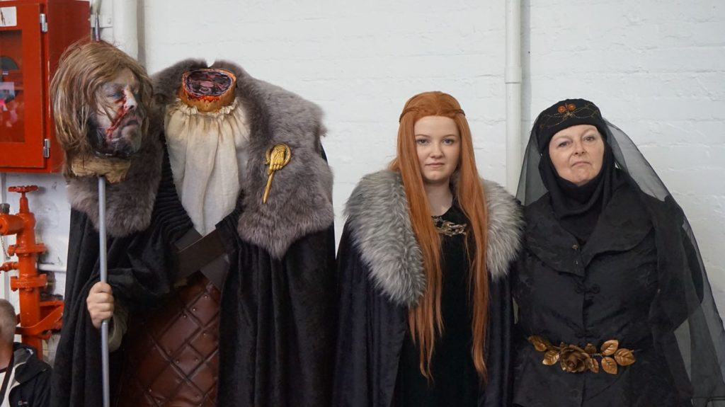 Dead Ned, Lady Sansa, and Lady Olenna cosplayers. Photo by @WightsKing