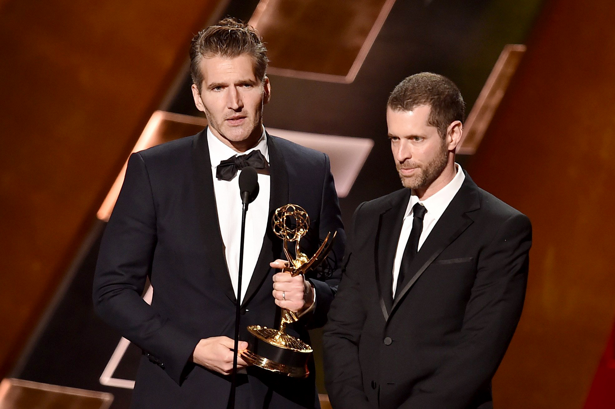 Showrunners David Benioff and D.B. Weiss accept writing award at 2015 Emmy Awards (Photo by Kevin Winter/Getty Images)