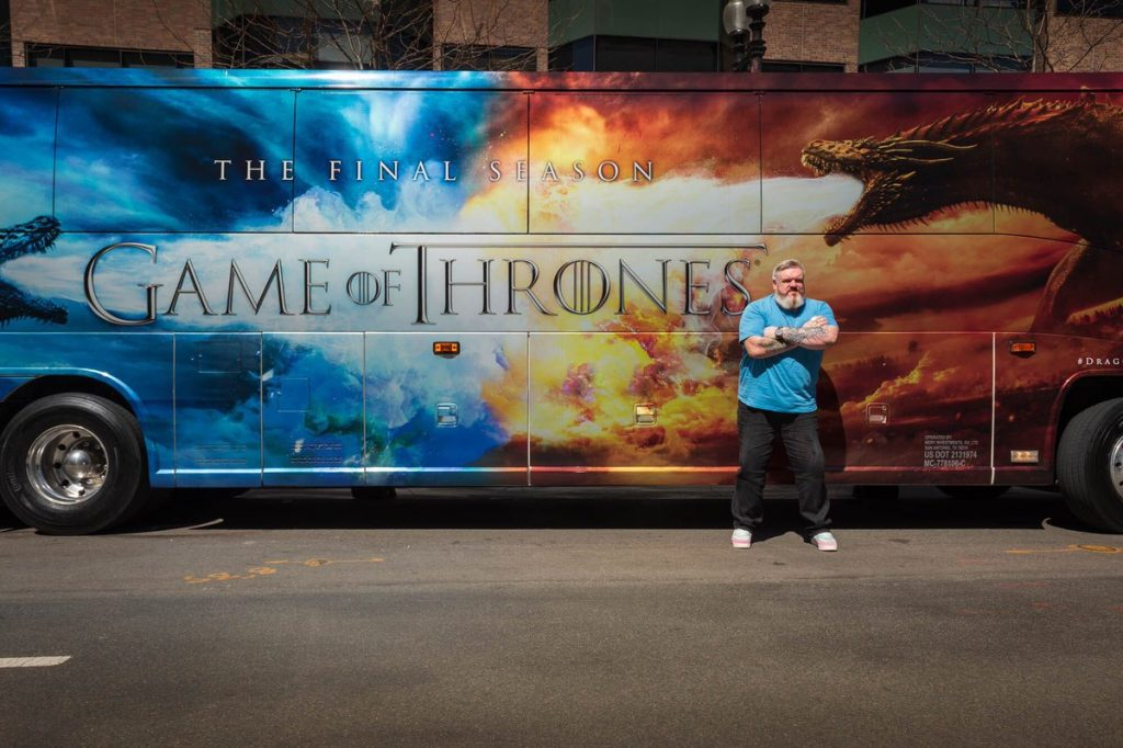 "Our beloved Hodor (Kristian Nairn) poses in front of the ""Dragon Wagon"" in Boston."