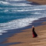 Emma Darcy alone on Holywell Beach