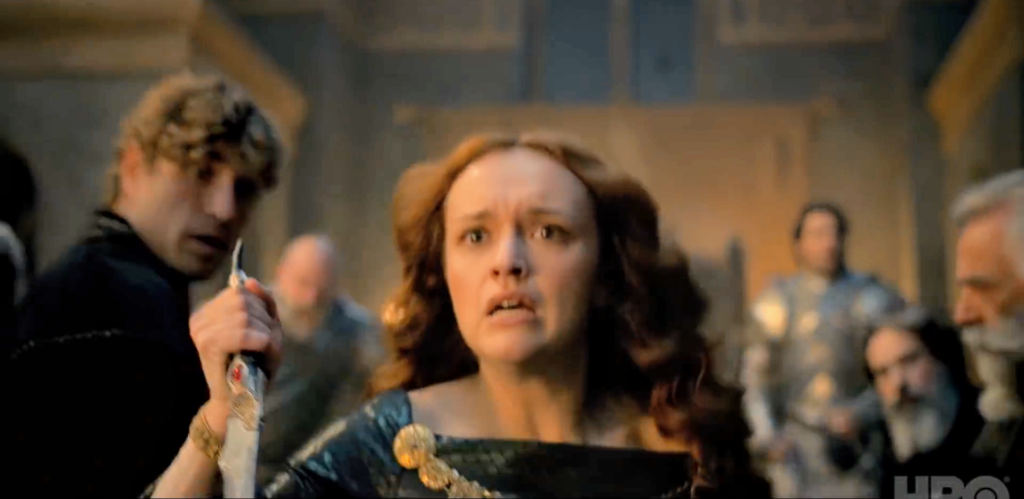 Olivia Cooke's Alicent Hightower runs through the crowd with a dagger in hand