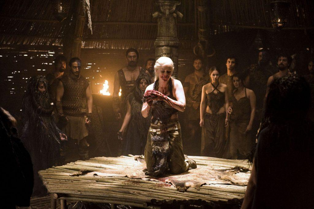 Daenerys Targaryen eating a horse's heart in the Temple of Dosh Khaleen