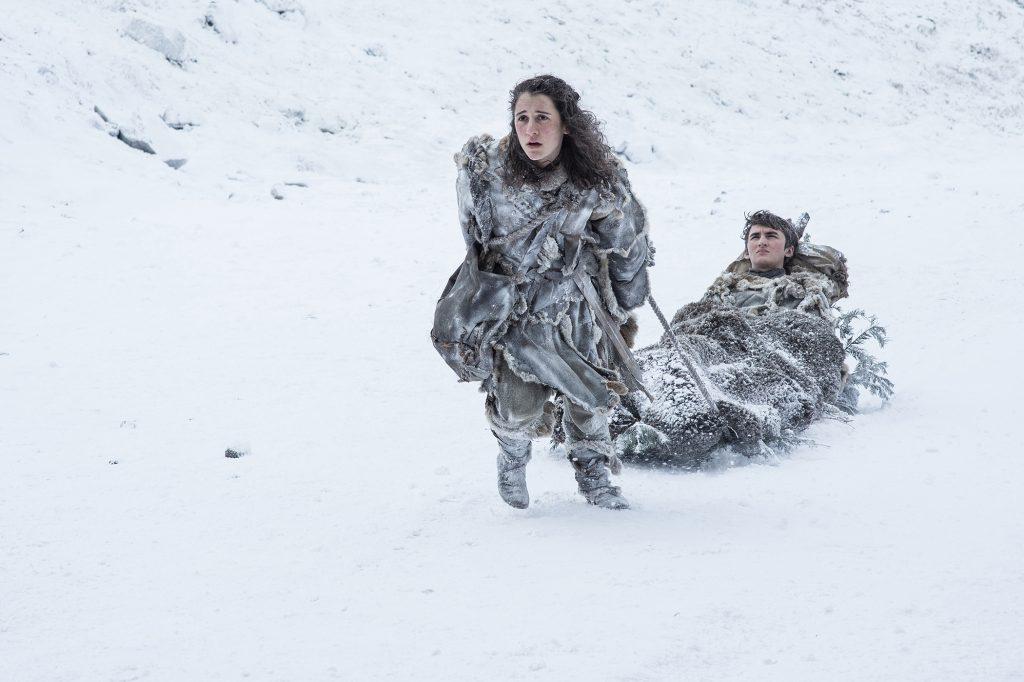 Meera Reed (Ellie Kendrick) carrying Bran Stark (Isaac Hempstead Wright) near the Wall / Photo: Helen Sloan/HBO