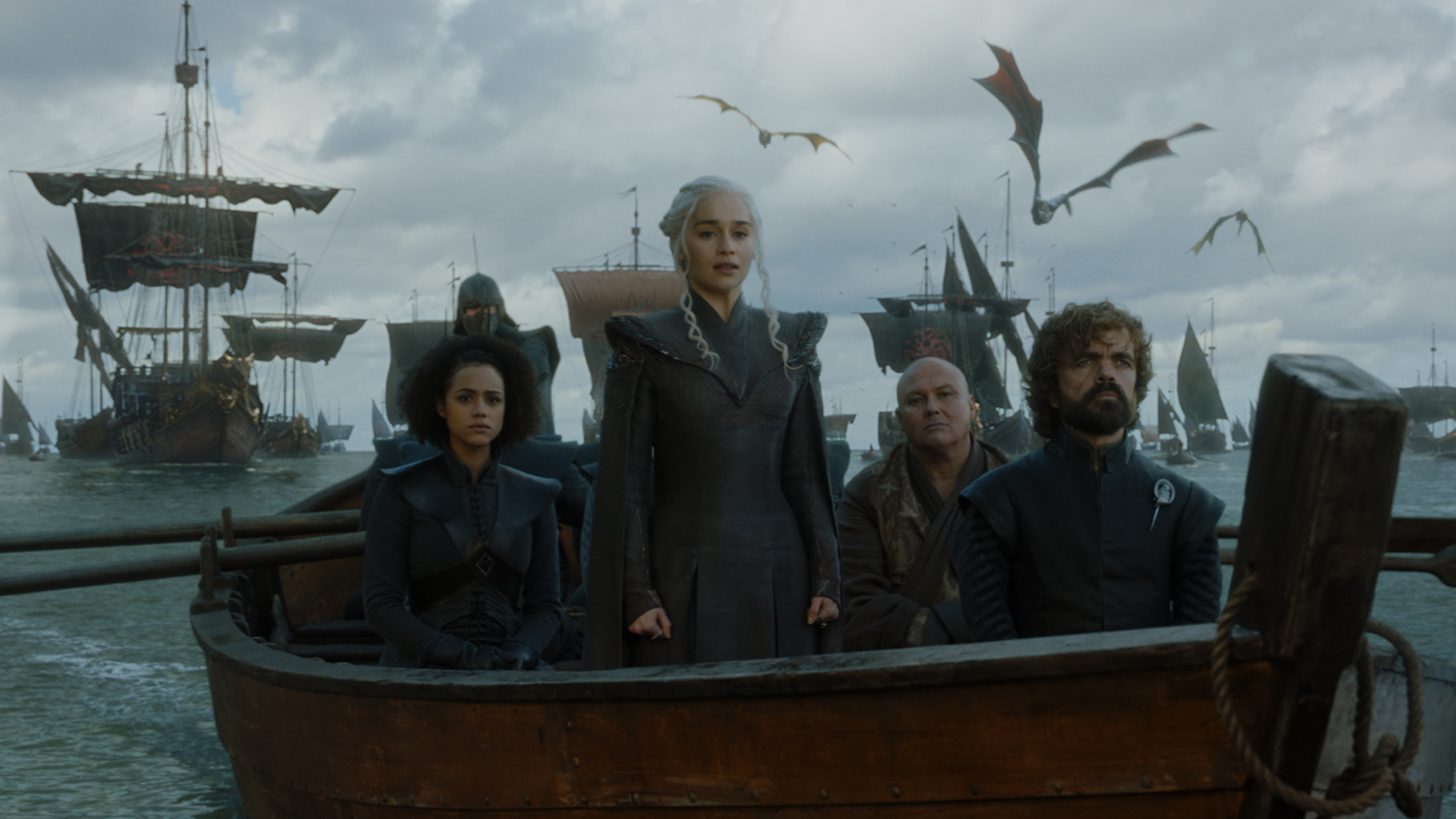Emilia Clarke as Queen Daenerys Targaryen, Peter Dinklage as Tyrion Lannister, Nathalie Emmanuel as Missandei, Conleth Hill as Varys arrive in Westeros. Photo: HBO.