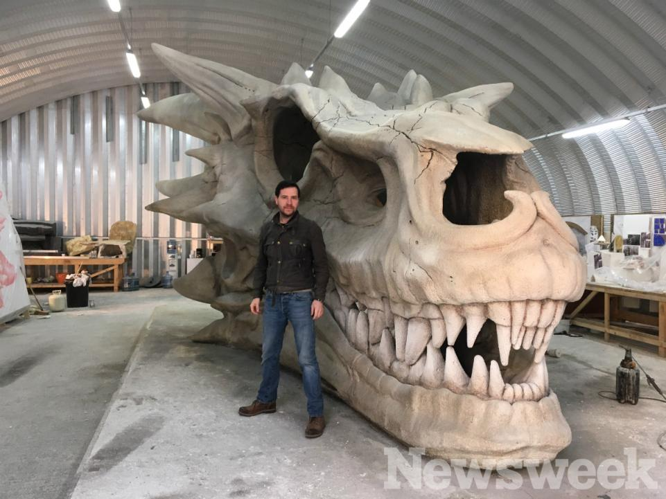 Darren Fitzsimons stands next to Balerion's enormous skull