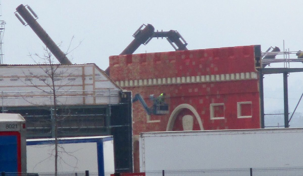 The wall is being detailed after a first red coat of paint. Photo: A Red Priestess