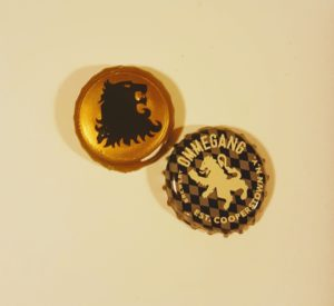 The Lannister lion foil and the Hand of the Queen's Ommegang bottlecap