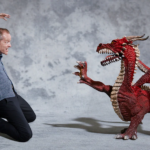 Iain Glen and an anatomically incorrect four-legged dragon. Photo by Franck Allais for The Telegraph