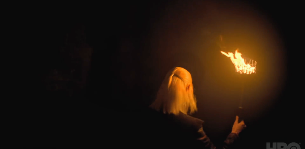 Prince Daemon walks with a torch through a dark cavern. Are these the old dragonglass caves of Dragonstone?