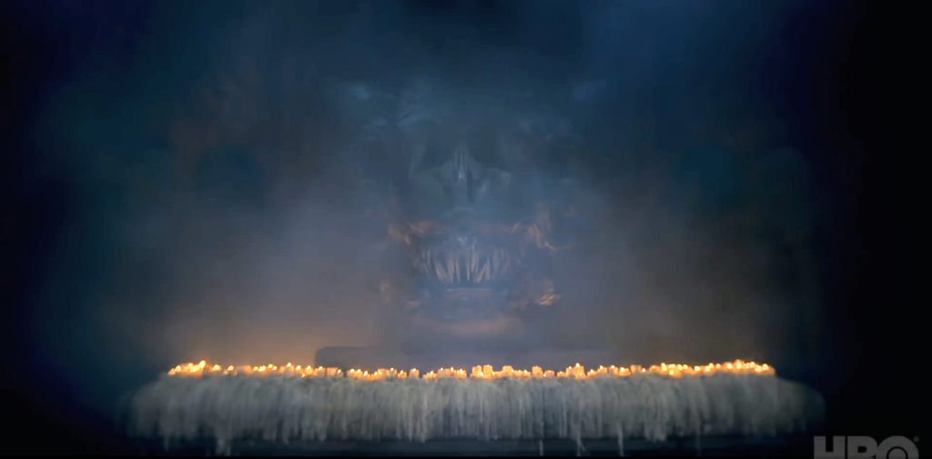 A dragon head surrounded by candles. Is this a statue, a skull, or a very still live dragon?