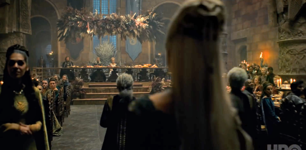 Steve Toussaint's Corlys, Eve Best's Rhaenys, Theo Nate's Laenor and their entire Velaryon ensemble enter the throne room